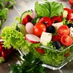 Vegetable salad bowl on kitchen table. Balanced diet.